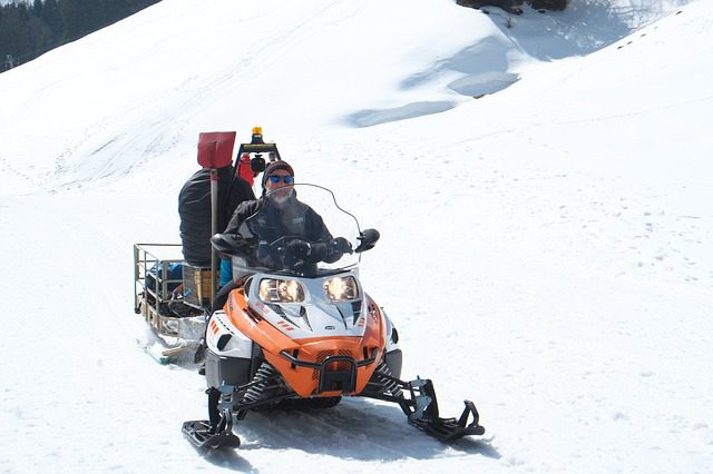 rider with muffpot on snowmobile