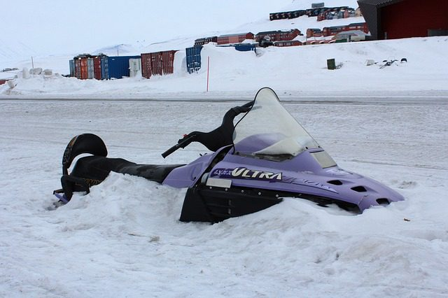 snowmobile stuck in inches of snow