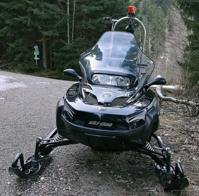 riding snowmobile on the ground