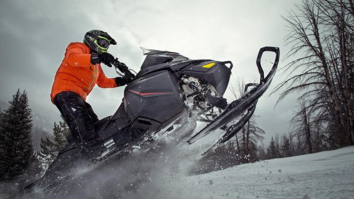 how does snowmobile suspension works